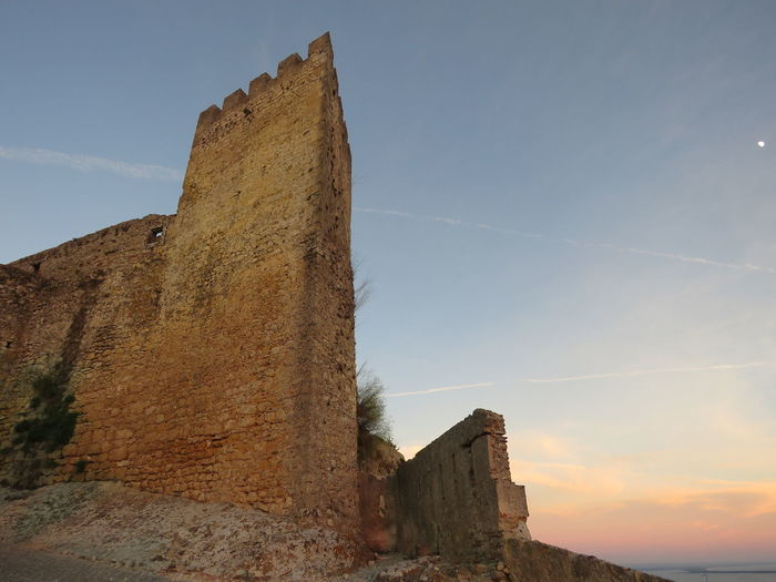 Low angle view of fort against sky