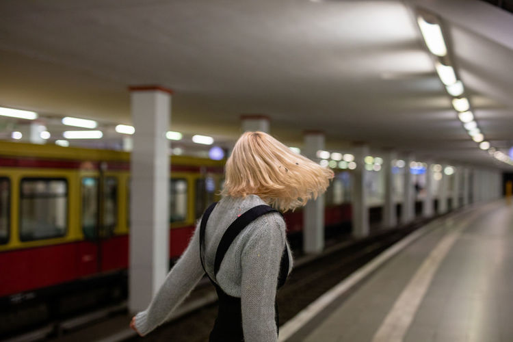 Side view of woman standing at railroad station platform