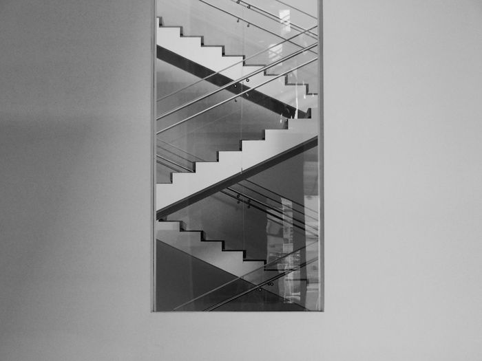 Architecture Steps And Staircases Staircase Built Structure Railing Building Exterior No People Day Building Spiral Modern Glass - Material Low Angle View Reflection Office Window Outdoors Copy Space Wall - Building Feature Glass Directly Below