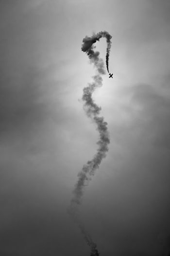 Falling Adventure Aerobatics Air Vehicle Airshow Black And White Blackandwhite Dark Day Extreme Sports Falling Fighter Plane Flying Formation Flying Jet Low Angle View Mid-air No People Outdoors Performance RISK Skill  Sky Smoke - Physical Structure Stunt Vapor Trail