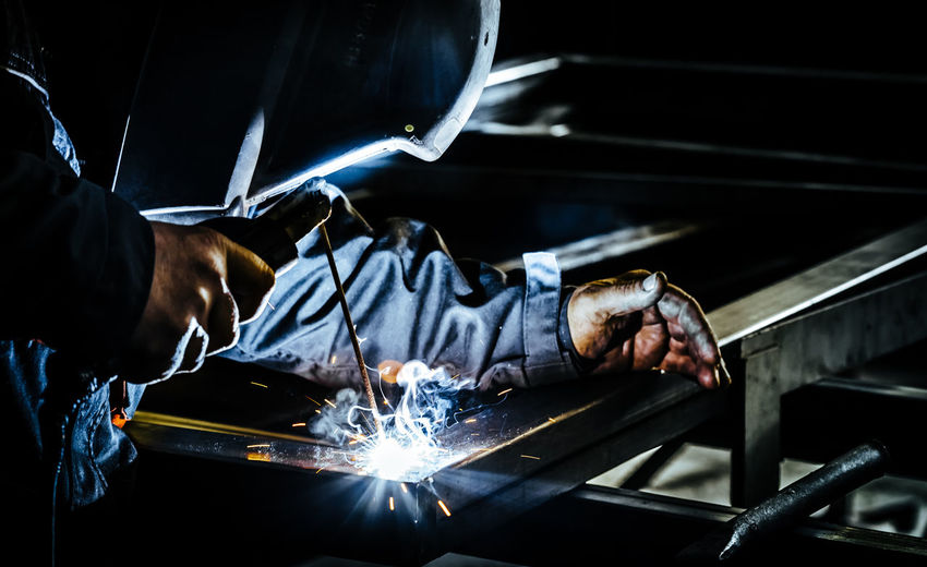 Welder welding in factory