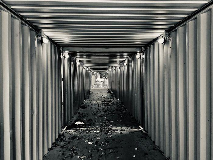Empty corridor in tunnel