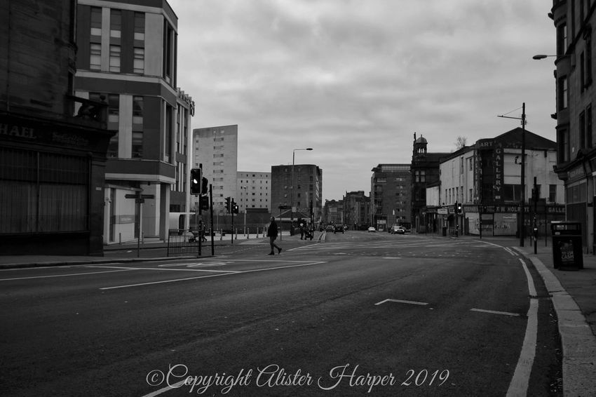 City Road Street Sky Architecture Building Exterior Built Structure Road Marking Zebra Crossing Empty Road Double Yellow Line Dividing Line Crossing Road Signal Crosswalk Information City Street Stoplight Road Sign Arrow Sign