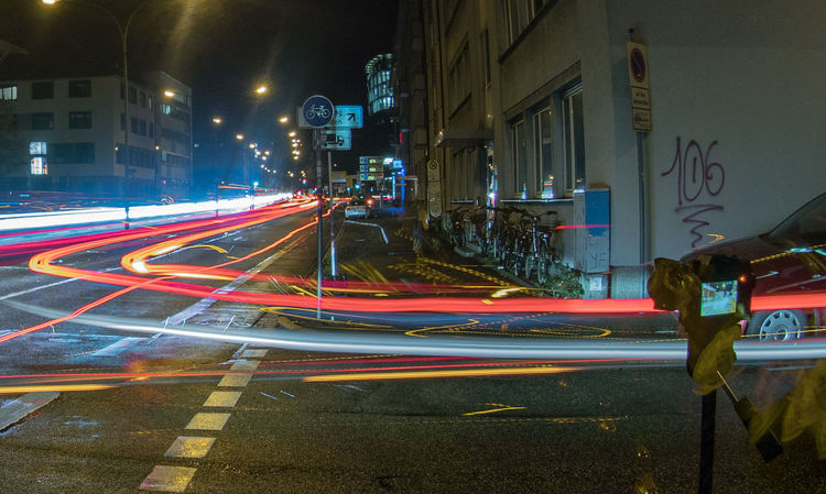 Camera - Photographic Equipment Architecture Building Exterior Built Structure City High Street Illuminated Light Trail Long Exposure Long Exposure Night Photography Motion Night No People Outdoors Road Speed Street Street Light Transportation Tripod Photography