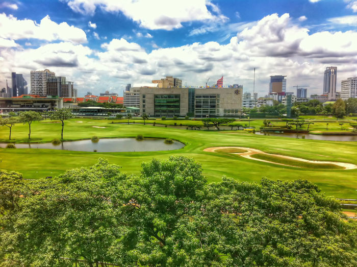 golf course in bangkok Architecture Blue Sky Bluesky Building Exterior City Cityscape Cloud Cloud - Sky Day Field Golf Course Grass Grassland Green Color Greensward Landscape Lawn Nature Outdoors Plant Sky Sunlight