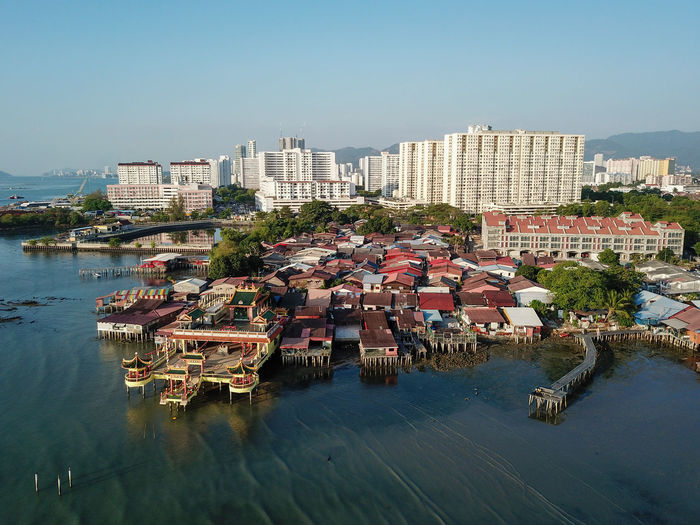 High angle view of buildings and river against clear sky
