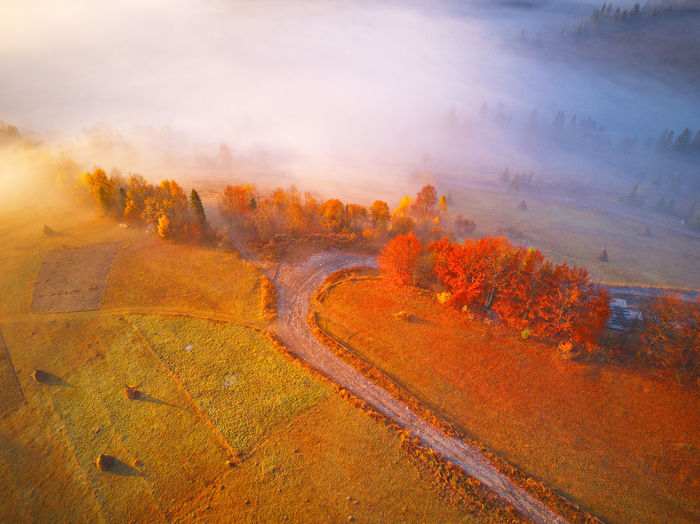 Scenic view of land against sky during autumn