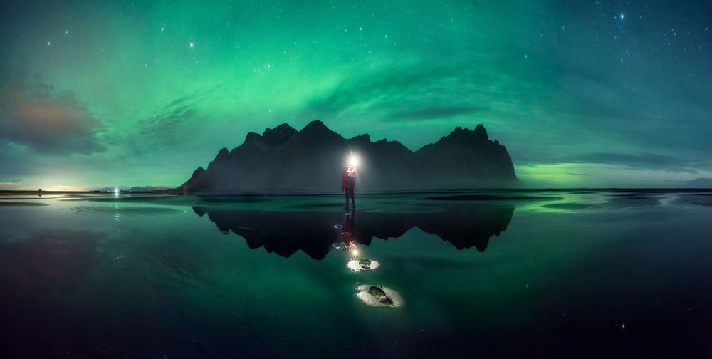 A Panorama in Stokness Iceland with the northern lights Aurora Borealis Beauty In Nature Cloud - Sky Iceland Iceland_collection Mountain Nature Night Northern Lights Outdoors Reflection Scenics Selfie Sky The Great Outdoors - 2017 EyeEm Awards Tranquil Scene Tranquility Water Waterfront Fresh On Market 2017