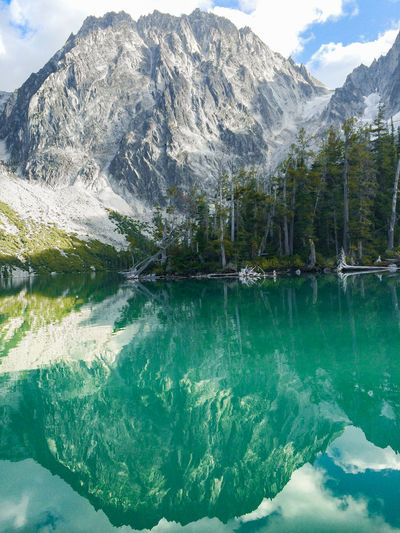 Glorious Colchuck Lake Portrait Adventure Beauty In Nature Colchuck Day Emerald Hiking Lake Lake View Landscape Mountain Nature No People Outdoors Portrait Reflection Scenics Sky Tranquil Scene Tranquility Tree Vacations Water