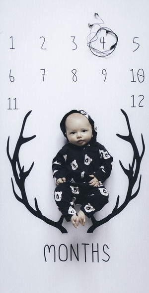 Child Childhood Front View One Person Indoors  Boys Text Portrait Males  Standing Representation Full Length Wall - Building Feature Number Western Script Communication Real People Casual Clothing Looking At Camera 4 Months Old Baby Newborn Looking At Camera