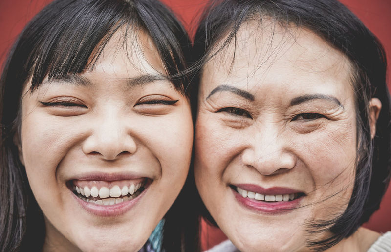 Asian mother and daughter having fun togheter Asian  ASIA Japan China Portrait Smiling Two People Happiness Women Close-up Family Lifestyles Human Face Front View Emotion Mother Daughter