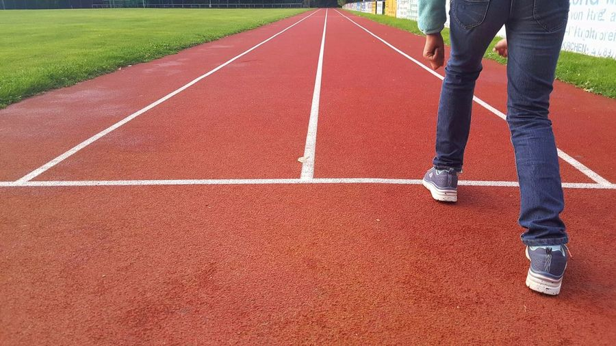 Low Section Of Person On Starting Line At Running Track