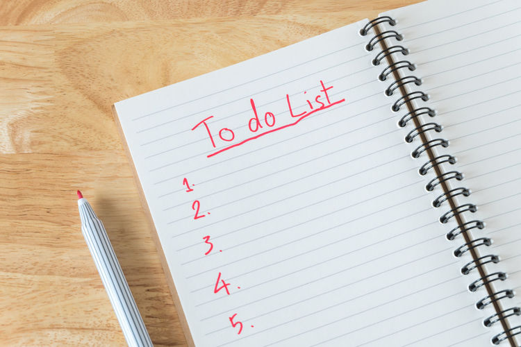 High angle view of to do list text on book at table