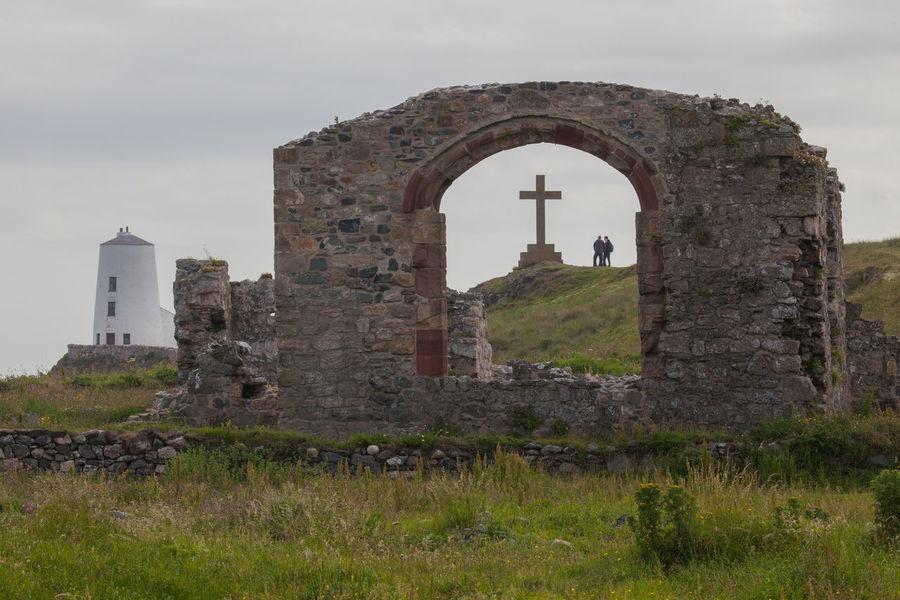 Anglesey Beach Britain Coast Coastline Cross Dwynwen Gwynedd Island Lighthouse Llanddwyn Island Religion Religious Architecture Ruins Summer Tidal Wales