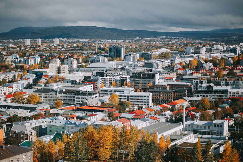 Iceland Reykjavik Travel Architecture Autumn Beauty In Nature Building Exterior Built Structure City Cityscape Cloud - Sky Day Europe High Angle View House Mountain Nature Outdoors Scenics Sky Tourism Town Tree