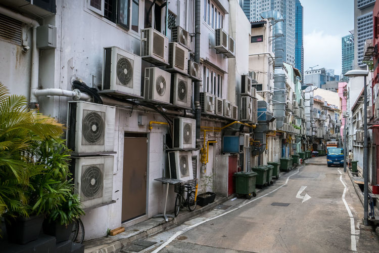 Air conditioner units crowding the side of a building in a Singapore alleyway Air Conditioner Air Conditioner Units Air Conditioner Ventilators Air Conditioning Units Alleyway Climate Energy Conservation Energy Consumption Environmental Extreme Temperature Global Warming Greenhouse Gas Greenhouse Gasses Heat And Humidity Heat Wave Humidity Ozone Save The Earth Save The Planet Singapore City Singapore Street Tropical Climate Urban Scene Urban Scenery Urban Scenes