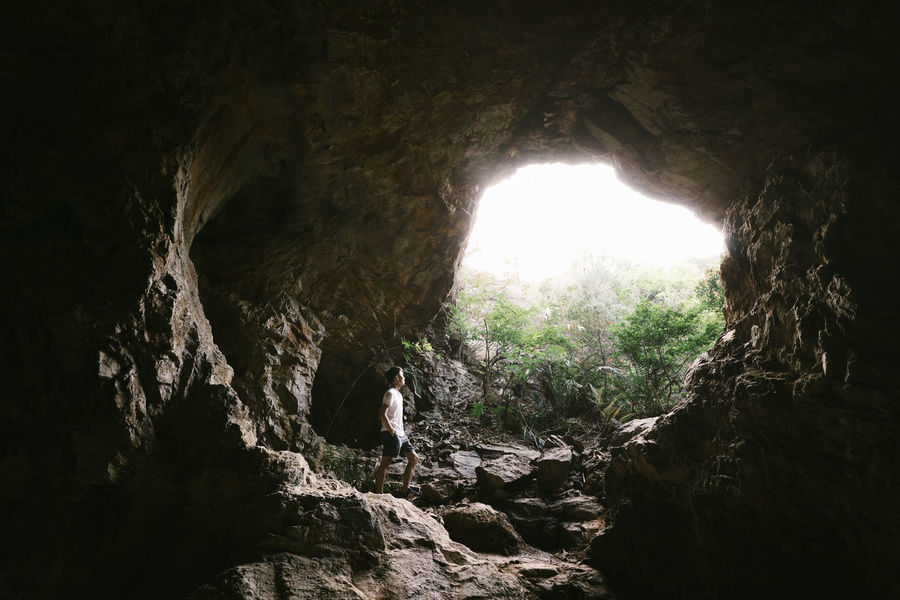 Searching the light Beauty In Nature Cave Day Illuminated Indoors  Limestone Low Angle View Natural Arch Nature No People Rock - Object Scenics Stalactite  Tranquility Tree Tunnel 2018 In One Photograph