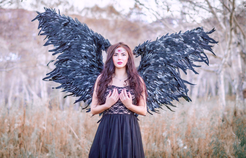 Portrait of beautiful young woman wearing angel costume