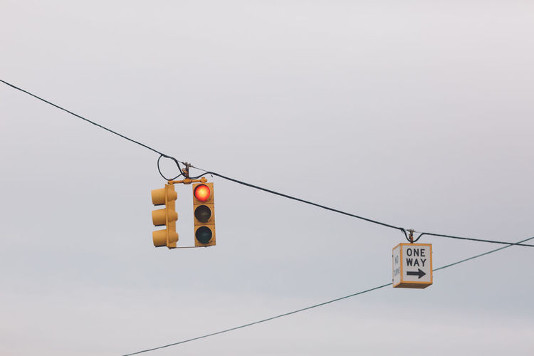 Cable Low Angle View Sky Hanging No People Electricity  Nature Connection Day Light Sign Copy Space Outdoors Clear Sky Technology Overhead Cable Car Road Signal Stoplight Power Line  Safety Power Supply
