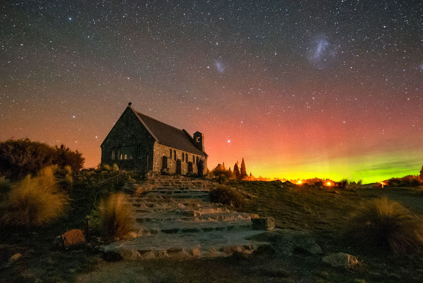 Aurora Australis emerged above Church of The Good Shepherd, New Zealand Architecture Atmospheric Mood Aurora Australis Building Building Exterior Built Structure Castle Church Of The Good Shepherd Cloud - Sky Famous Place History House Leading New Zealand No People Old Ruin Outdoors Religion Residential Structure Sky Spirituality Town Travel Destinations Tree UNESCO World Heritage Site