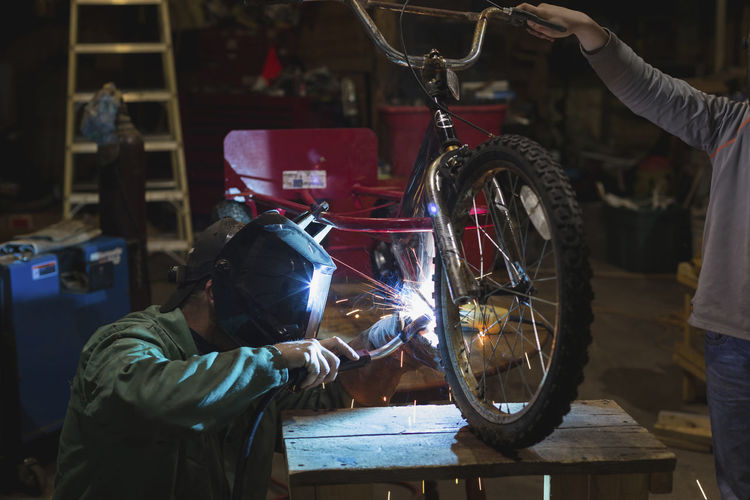 Man working on bicycle in garage