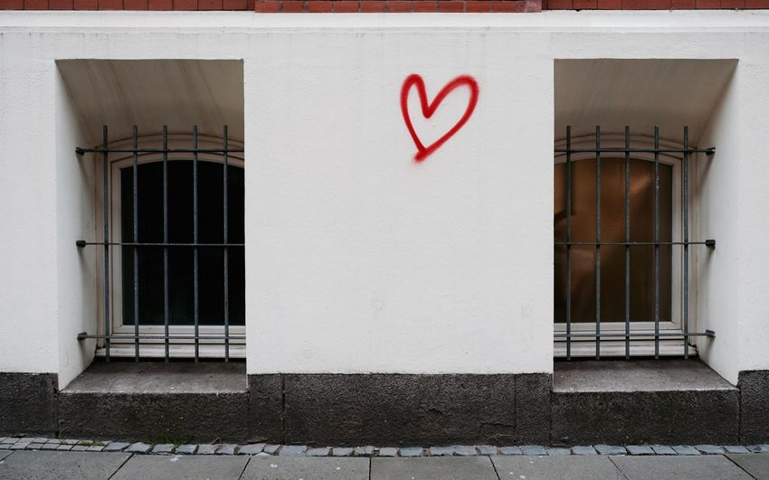 Unhappily in love ... Architectural Detail Architecture Barred Windows Bars Building Exterior Built Structure City Life Day EyeEmNewHere Facade Detail Graffiti Heart Heart Shape Love Love Doesn't Know Distance Lovesick No People Outdoors Street Photography Streetphotography Symbolic  Symbolism Two Of A Kind