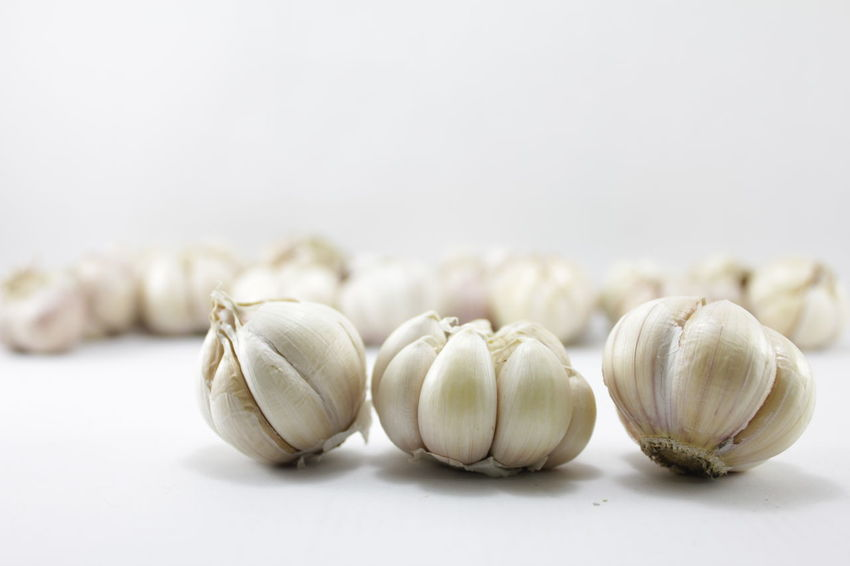 Garlic on a white background Garlic On A White Background Close-up Day Food Food And Drink Freshness Garlic Garlic Bulb Healthy Eating Indoors  No People Plant Bulb Raw Food Still Life Studio Shot Table Vegetarian Food White Background