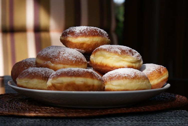 Close-Up Of Donuts In Plate On Table