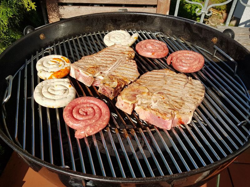 Barbecue Grill Meat Grilled Food And Drink High Angle View Food Barbecue Preparation  No People Outdoors Day Sausage Freshness Ready-to-eat Close-up Beef Steaks T-bone T-bone Steak Summer Party Looking Up