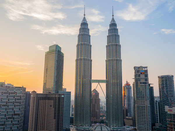 Twin towers in Kuala Lumpur at sunset Twin Towers Kuala Lumpur Kuala Lumpur Twin Tower Kuala Lumpur Malaysia  Kuala Lumpur City Centre Built Structure Capital Cities  City Life Malaysia Office Building Outdoors Petronas Twin Towers Scenics Skyscraper Tall - High Tower Urban Skyline Been There.