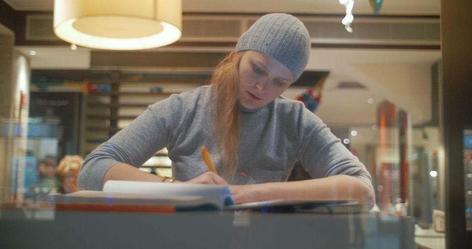 Young woman looking at illuminated table