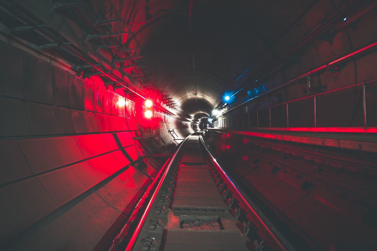 illuminated, red, night, the way forward, transportation, lighting equipment, railroad track, tunnel, rail transportation, built structure, indoors, architecture, no people