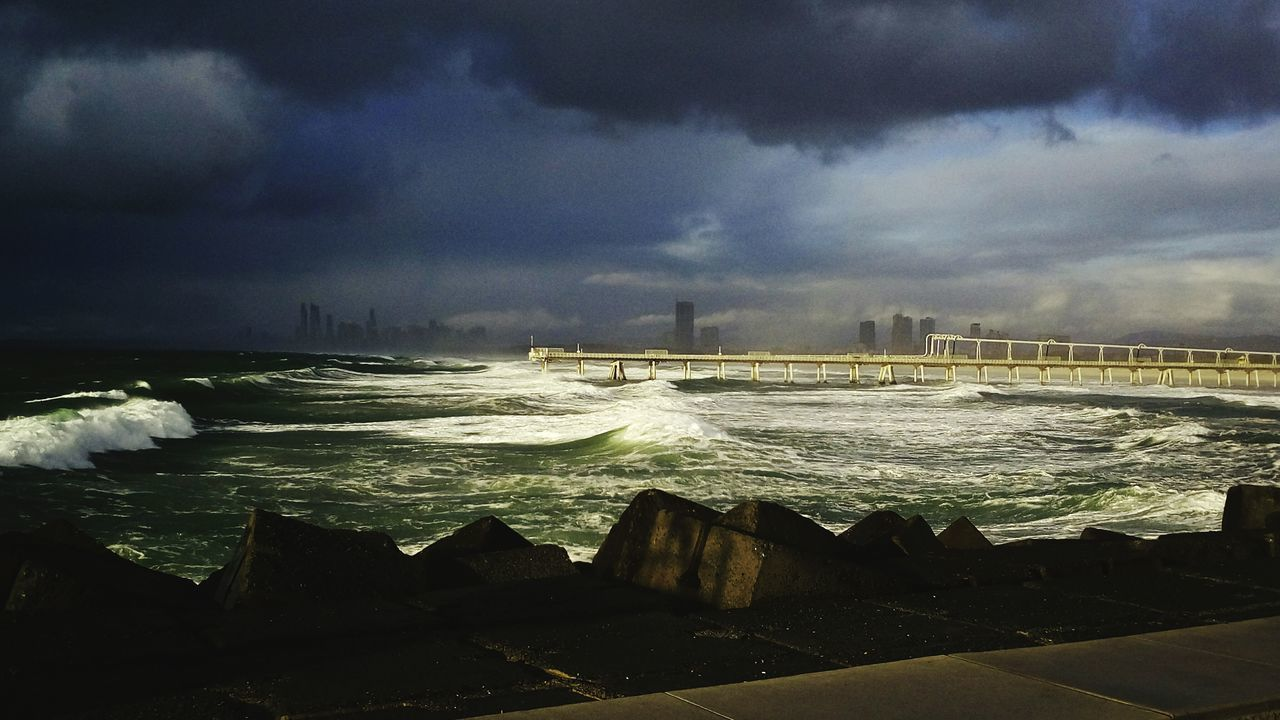 sea, water, sky, wave, cloud - sky, no people, nature, outdoors, beauty in nature, architecture, travel destinations, built structure, storm cloud, power in nature, scenics, motion, building exterior, day, horizon over water