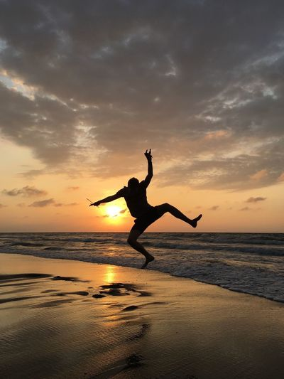 Happy In Sunset Arms Raised Beach Beauty In Nature Cloud - Sky Energetic Excitement Flexibility Full Length Horizon Over Water Jumping Men Mid-air Motion Nature One Person Outdoors Real People Reflection Scenics Sea Silhouette Sky Sunset Tranquility Water Sommergefühle