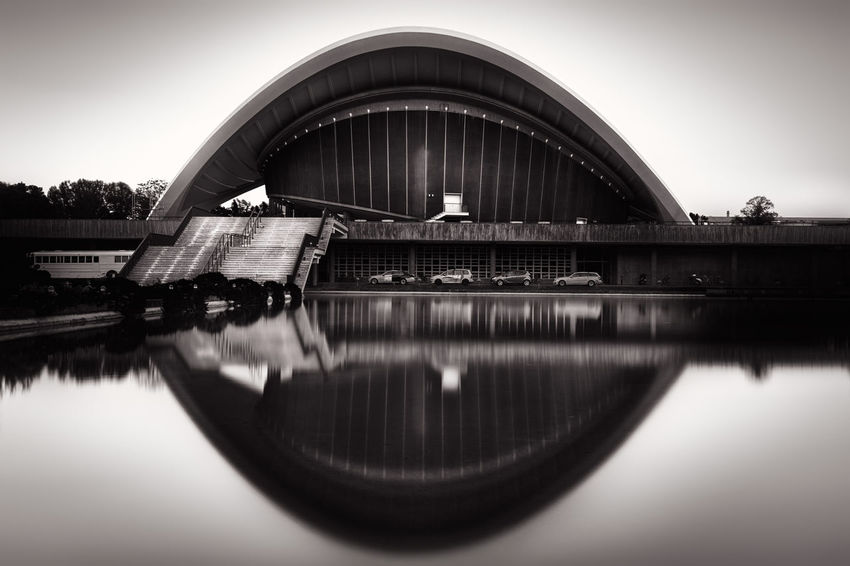 House of the World's Cultures in Berlin/ Germany. Architecture Berlin Berliner Ansichten Blackandwhite Built Structure Capital Cities  City City Lights Day Engineering Fine Art Photography Fineart_photobw Haus Der Kulturen Der Welt Hkw House Of The World's Cultures No People Outdoors Reflection Reflections In The Water Sky Tranquility Travel Photography Urban Icon Water Waterfront