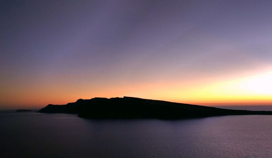 || Nature Theories || Santorini, Greece. TheFoneFanatic Vacations Mobilephotography PhonePhotography Scenics Lowlight Colorful Landscape Sea Mountain Sunset Sky Horizon Over Water Landscape Volcanic Landscape Summer In The City #urbanana: The Urban Playground