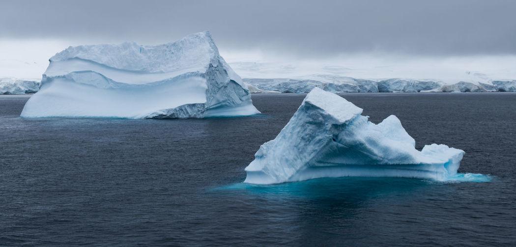 Scenic view of frozen sea against sky. antarctica