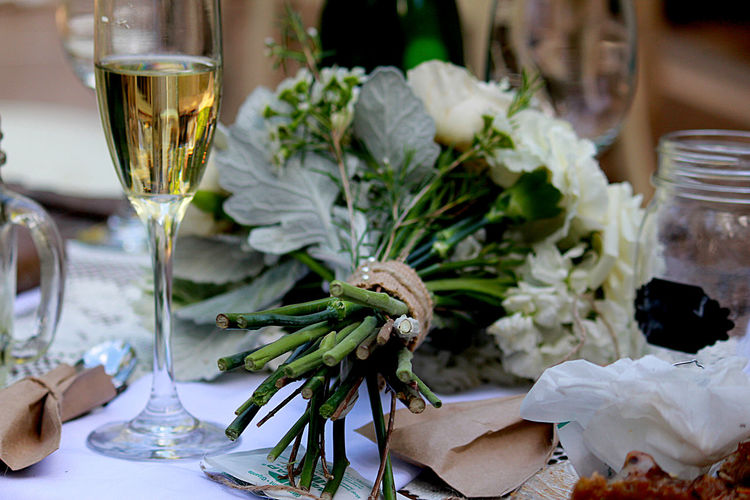 Close-Up Of Bouquet And Champagne Flute On Table