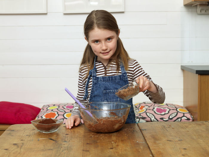Girl holding ice cream at home
