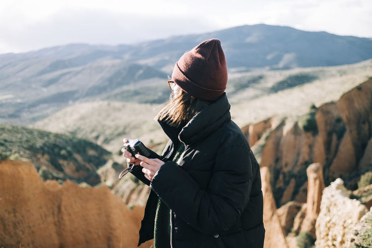 Man photographing camera on mountain
