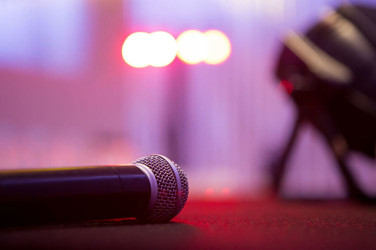 Close-up of microphone on stage