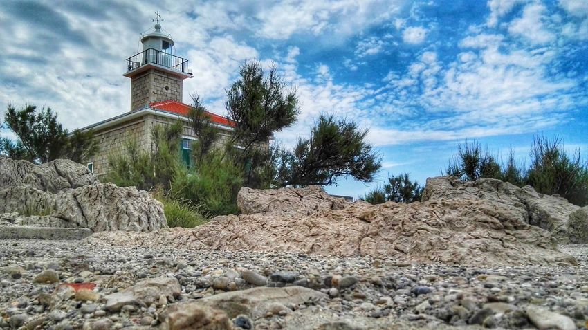 Building Rocks Trees Lighthouse From My Point Of View From Where I Stand Nature Clouds And Sky Landscape Plants Holidays In Croatia The Essence Of Summer Makarska Croatia EyeEm Nature Lover Rock - Object Stones Plants 🌱 (Makarska, Croatia - July 2016)