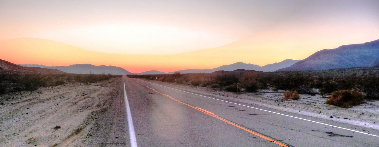 Empty road as far as the eye can see leaving Borrego Springs in the summer as the sun disappears. Clear Sky Countryside Diminishing Perspective Empty Empty Road Landscape Lonely Road Long Mountain Range Nature Non-urban Scene Orange Color Outdoors Remote Road Road Marking Solitude Sunset Surface Level The Way Forward Tranquil Scene Tranquility Vanishing Point