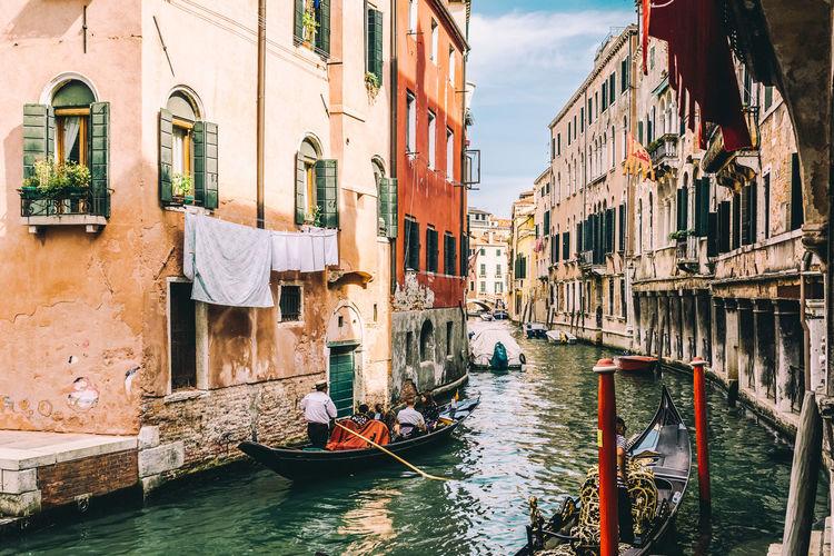 Gondolas Amidst Buildings In City
