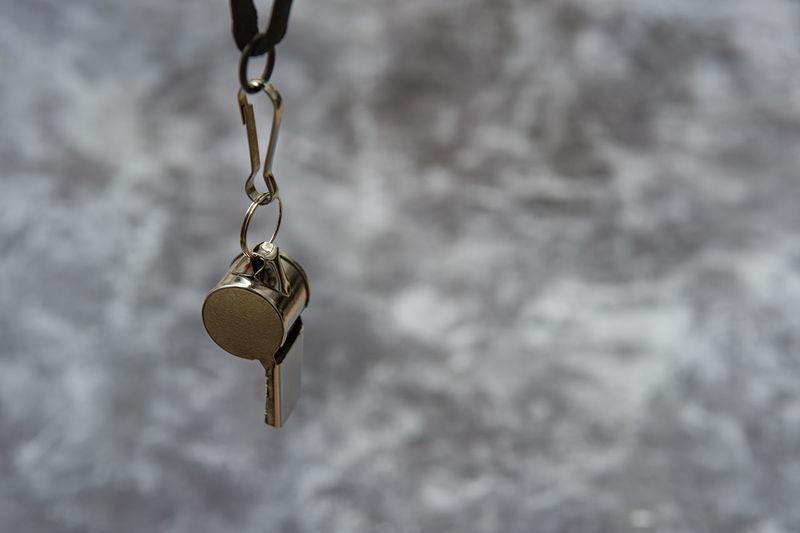 Low angle view of padlocks hanging on metal