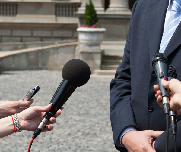 Media interview. Broadcast journalism. Interview Journalist Mic PR Press Business Person Holding Human Hand Information Information Medium Interviewing Journalism Mass Media Media Media Event Media Interview Microphone News News Conference Outdoors Public Relations Report Reporter Unrecognizable Person