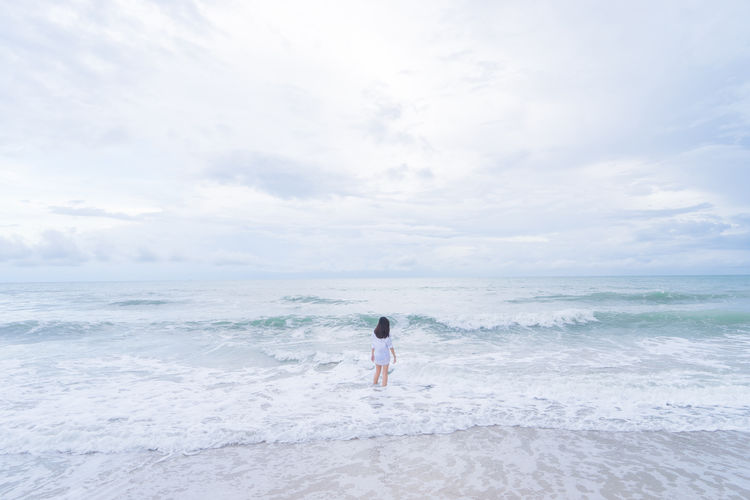 Go Back in to the Sea Adventure ASIA Beach Cloud - Sky My Year My View Backgrounds Landscape Lonely Minimalism Nature Ocean One Person Outdoors People Sand Sand & Sea Scenics Sea Sea And Sky Seascape Sky Finding New Frontiers Vacations Wave Woman