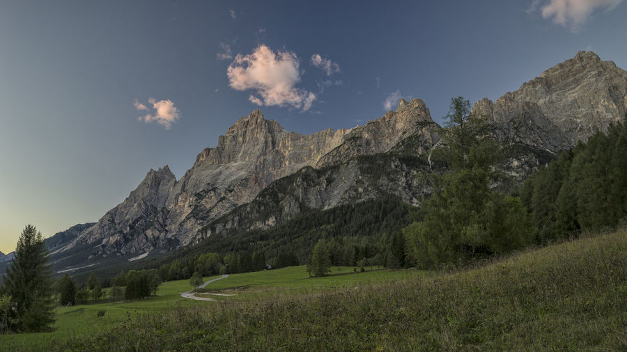 Dolomites North Italy Alps Beauty In Nature Day Grass Italy Landscape Mountain Mountain Range Nature No People Outdoors Pink Clouds San Vito Di Cadore Scenery Scenics Sky Sunset Tranquil Scene Tranquility