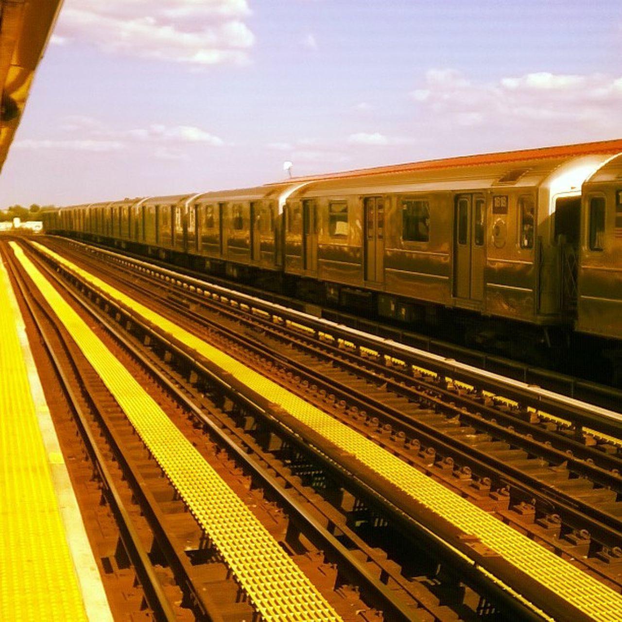 transportation, railroad station platform, train - vehicle, railroad track, public transportation, rail transportation, railroad station, station, journey, subway train, no people, sky, outdoors, day
