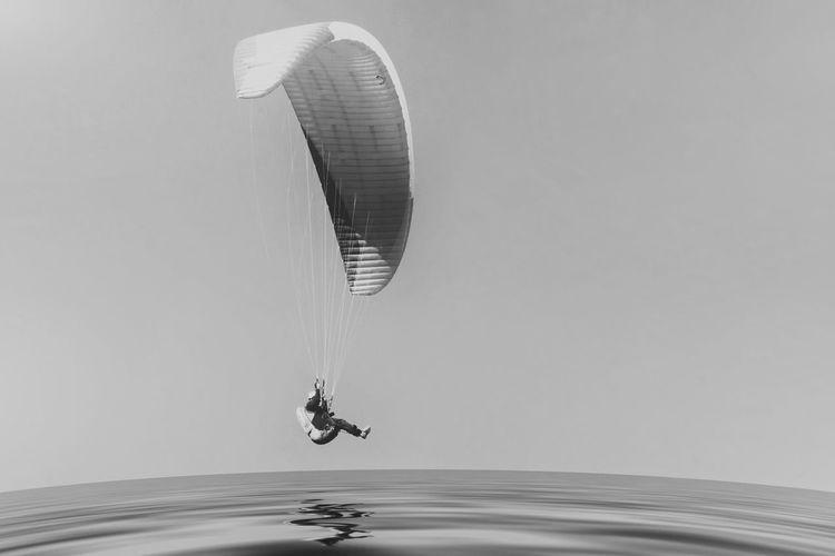 Paragliding over the Danish North Sea coastline on blue sky background Denmark Denmark Love ❤️ Flying High Fun Paragliding Paragliding Fun Action Action Shot  Active Active Lifestyle  Active Sealife Adventure Flying Løkken Lønstrup Paragliding Over Water Paragliding Pilot Sea Sea And Sky Sport